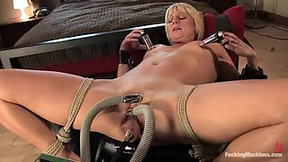 Lusty blond is getting high on a fucking machine