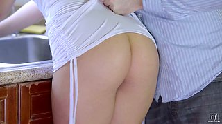 Cute blonde babe Kate England gives titjob and gets poked in the kitchen