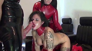 Two sluts in red latex play with each other and fuck guy