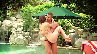 Short-haired redhead sucks and gets banged by the pool