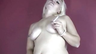 Blonde slut smoking while rubbing her big tits