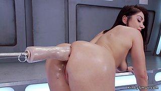 Busty beauty takes anal fist machine