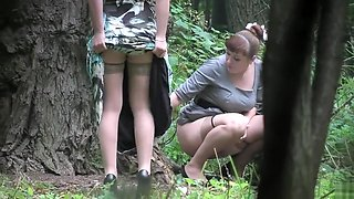 Beautiful Russian honeys get spied on while urinating in the park