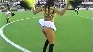 A sizzling view up the skirts of dancing cheerleaders in tiny thongs