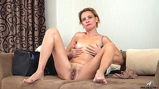 Playful and feeling bored lady Oliya is ready for solo masturbation