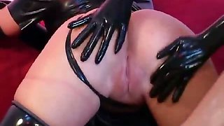 Superb lesbian slave in latex Petova gets pussy licked by a