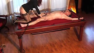 Smoking hot dominatrix punishes her male slave