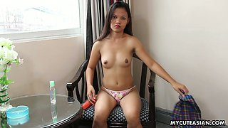 Naughty Filipina coed is fucking her tight muff with her huge dildo at home