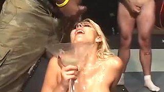 Cute blonde enjoys a gokkun bukkake orgy
