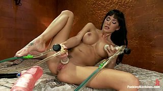 Busty brunette Gia Dimarco gets her vag banged by a fucking machine