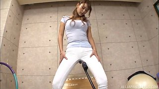 wakana nao opens her legs in white jeans for a sex machine