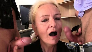 Blonde skinny granny swallows two cocks for job