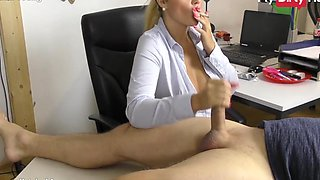 Busty secretary gives her boss a handjob at the office while smoking