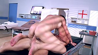 A large man is stretching his doctors pussy in the exam room