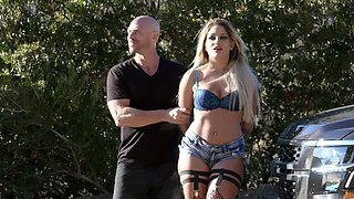 Bald stud with a large dick is ready to fuck a glamorous hooker outdoors