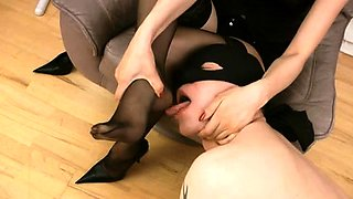 Dominant brunette in stockings makes her slave lick her feet