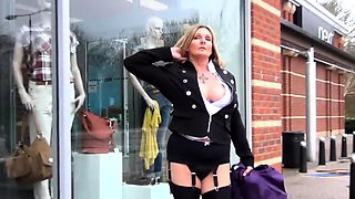 Naughty blonde milf in lingerie flaunts her curves in public