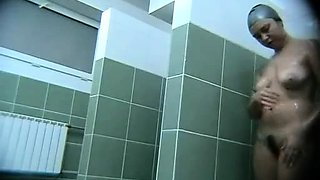 Hot busty on a voyeur video from the swimming pool showers