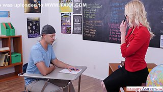Skinny blonde teacher is fucking her handsome student in the classroom, while no one is watching