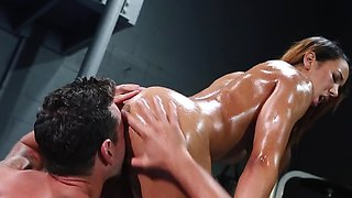 Muscular Latin babe oiled up and banged in the gym