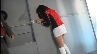 Pretty Oriental girl in uniform is made to reach her climax